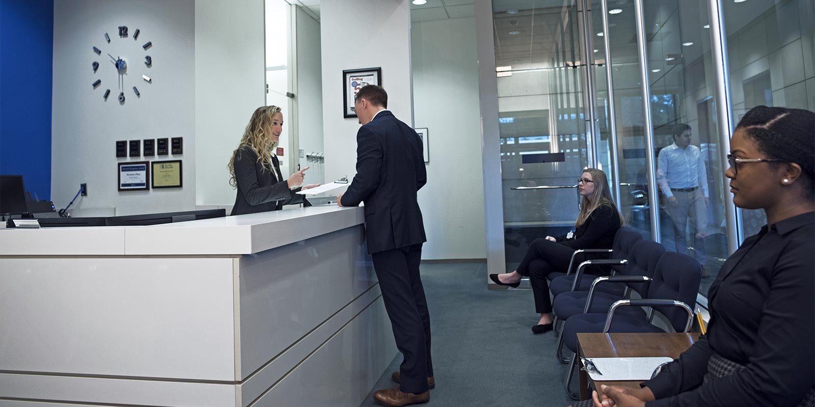 Applicant talking to a receptionist