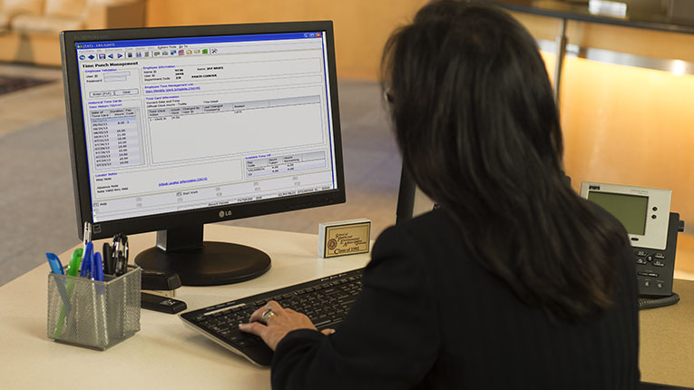 Image of woman working at computer